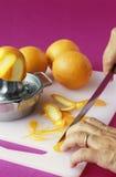 Making orange zests Royalty Free Stock Photo