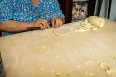 Making orecchiette in Bari. Home made traditional orecchiette in old town bari Royalty Free Stock Photography