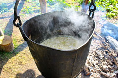 Making organic cheese in mountain farm. Making organic cheese in a mountain farm royalty free stock photography