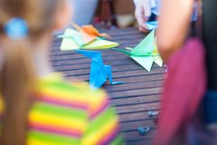 Making origami, working with colored paper, children mold from paper stock image