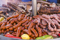 Making an outdoor barbeque. Outdoor barbeque with sausages, sausages and peppers pork ribs Royalty Free Stock Photos