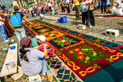 Making a Palm Sunday carpet, Antigua, Guatemala. Antigua, Guatemala -  April 17, 2011: Making a  Palm Sunday carpet in path of religious procession using wooden Royalty Free Stock Images