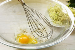 Making pancake batter for sweet fried elderflowers, bowl with in Royalty Free Stock Images