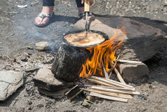 Making pancake on the campfire Stock Images