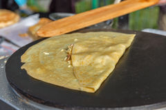 Making pancake with filling on frying electric stove Stock Image