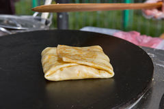 Making pancake with filling on frying electric stove Royalty Free Stock Photos