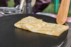 Making pancake with filling on frying electric stove Stock Photography