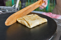 Making pancake with filling on frying electric stove Royalty Free Stock Photography