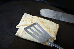 Making pancakes Stock Photos