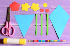 Making paper crafts for mother`s day or birthday. Step. Cut details, scissors, glue stick, flowers templates, pencil on a table Stock Photography