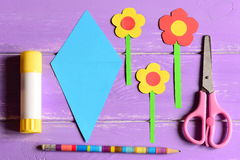 Making paper crafts for mother`s day or birthday. Step. Paper flowers, scissors, glue stick, flowers templates, pencil on a table Royalty Free Stock Image