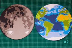 Making paper mockup of the moon and earth stock image