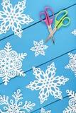 Making Paper Snowflakes Royalty Free Stock Photo