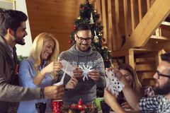 Making paper snowflakes royalty free stock image