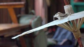 Making paper umbrella stock video