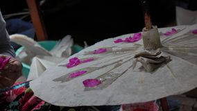 Making paper umbrella stock footage