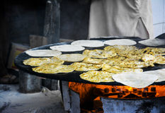 Making Paratha. S on a stove royalty free stock photography