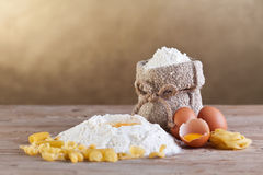Making pasta. From natural ingredients - with copy space, in warm tones Royalty Free Stock Image
