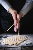 Making pasta by female hands Royalty Free Stock Photos