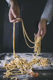 Making pasta by female hands Royalty Free Stock Image