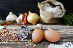 Making pasta ravioli on old wooden table with flour, eggs, kitch. Preparation for making pasta ravioli on old wooden table with flour, eggs, kitchen italian Royalty Free Stock Image