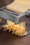 Making pasta with traditional machine Stock Photos