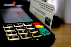 Making payment with credit card on the pos stock photos