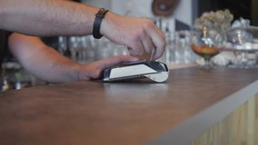 Making payment with credit card and pos terminal, printed check. a coffee shop stock footage