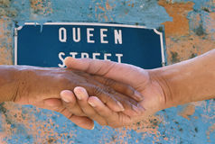 Making peace at Queen Street. Hands holding each other at Queen Street Stock Image