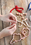 Making a pearl necklace Stock Photo