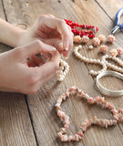 Making a pearl necklace Stock Photos