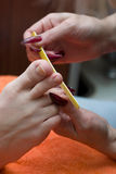 Making pedicure Stock Images