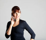 Making a phone call. Portrait of a beautiful and attractive young woman making a phone call Royalty Free Stock Images