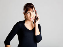 Making a phone call. Portrait of a beautiful and attractive young woman making a phone call Stock Images