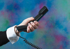 Making a phone call at the office Stock Images