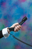 Making a phone call at the office Royalty Free Stock Image