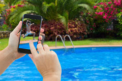 Making photo of boy jumping in pool stock images