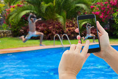 Making photo of boy jumping in pool Stock Photos