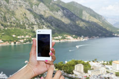 Making photo with cellphone Stock Photos