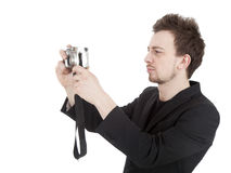 Making photo young man with camera Stock Photo