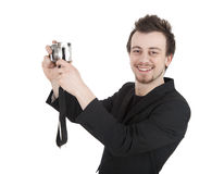 Making photo young man with camera Stock Photography