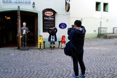 Making photopics. A couple making photo set in front of a restaurant royalty free stock image