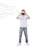 Making photos with mobile device. Teenager is making photos with mobile device, isolated on white, clipping path Royalty Free Stock Photography