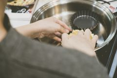 Making pie crust on frypan royalty free stock photography