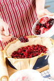 Making pie with frozen fruits Stock Image