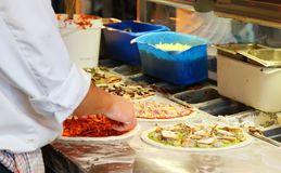 Making Pizza. Chef Making Assorted Pizzas in a Restaurant Royalty Free Stock Photography