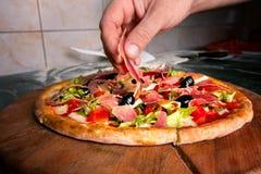 Making pizza stock photos