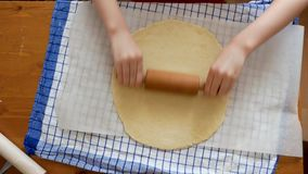 Making pizza or pide dough by close up girl hands in pastry kitchen, shaping dough is precursor to making a wide variety of food s stock footage