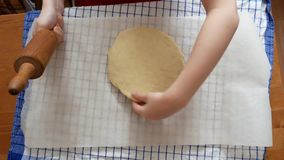 Making pizza or pide dough by close up girl hands in pastry kitchen, shaping dough is precursor to making a wide variety of food s. Tuffs, particularly breads stock footage