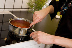 Making Pizza Sauce on Stove Royalty Free Stock Image